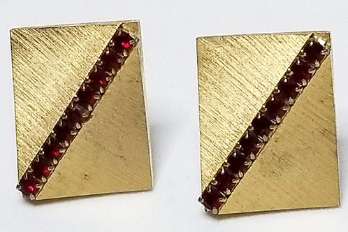 Designer by Sarah Coventry, cuff links, red rhinestones in brushed gold tone.