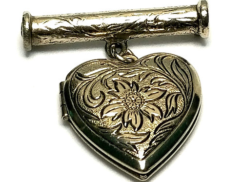 Designer by provenance, brooch/locket, floral heart motif, silver tone.