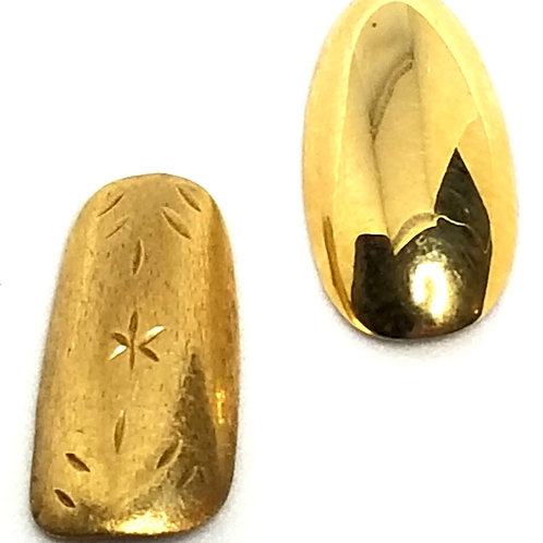 Designer by provenance, 14K gold false pinky fingernails (two).