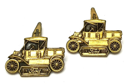 Designer by Provenance, cuff links, Ford motif, gold tone 1 1/8 x 5/8 inches.