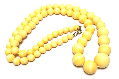 Designer by provenance, necklace, graduated yellow beads, gold tone, 26 inches.