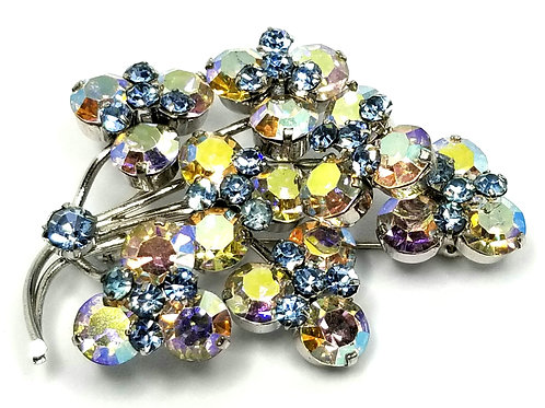 Designer by provenance, brooch, aurora borealis and blue rhinestones.