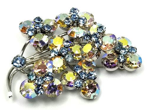 Designer by provenance, brooch, aurora borealis and blue rhinestones.
