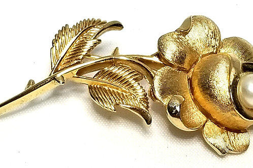 Designer by Trifari, brooch, rose motif with faux pearl in gold tone.