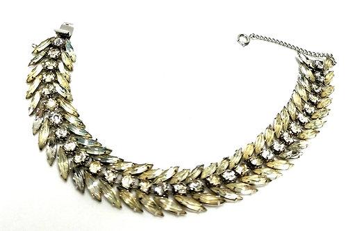 Designer by Napier, bracelet, flower motif, clear rhinestones in silver tone.