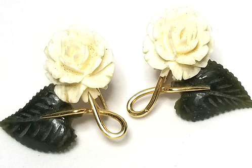 Designer by Krementz, earrings, screw back, flower motif, cream and green.