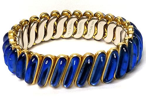 Designer by The D.F.B. Co., stretch bracelet, blue glass stones on gold tone.