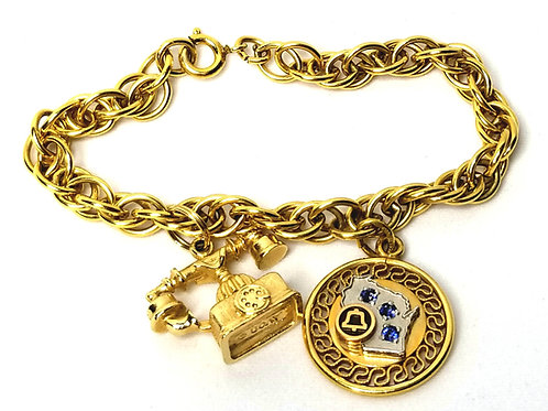 Designer by Avon, charm bracelet, telephone motif, gold tone, 7 inches.
