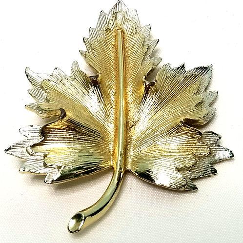 Designer by Sarah Cov, brooch, leaf motif in silver tone and gold tone.