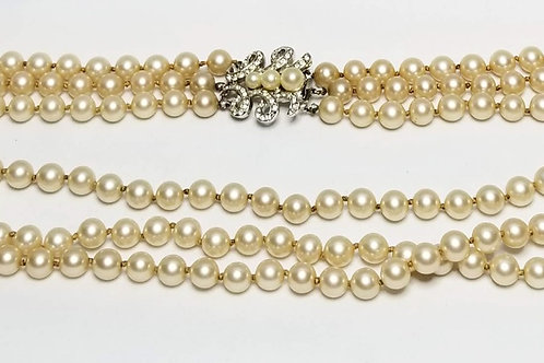 Designer by Marvella, pearl triple strand necklace with rhinestones silver tone.