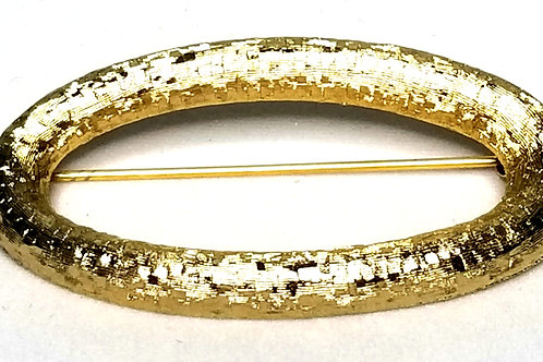 Designer by Monet, brooch, oval shaped, gold tone 2 x 1 inch.