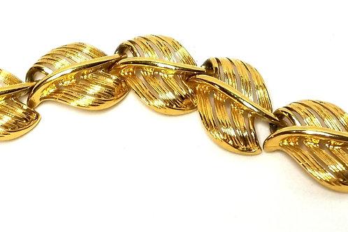Designer by Napier, bracelet, leaf motif, gold tone links, 7 inches.