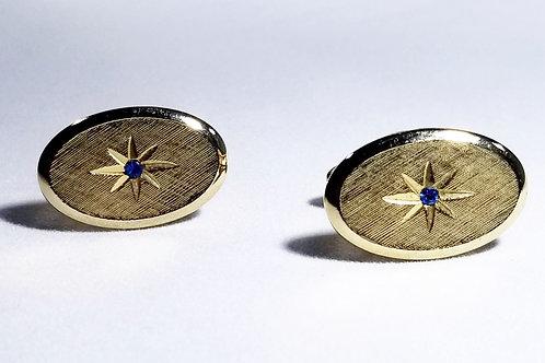Designer by Avon, cuff links, blue rhinestone starburst, gold tone