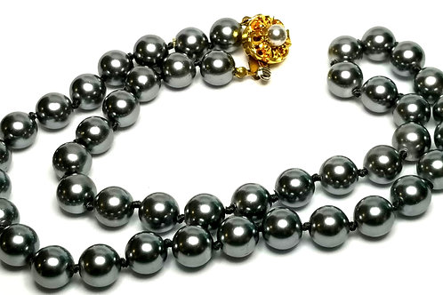 Designer by provenance, necklace, grey faux pearls, gold tone clasp, 22 inches.