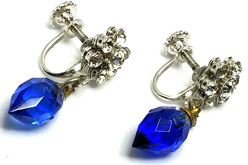 Designer by provenance, earrings, screw backs, blue faceted stones, silver tone.