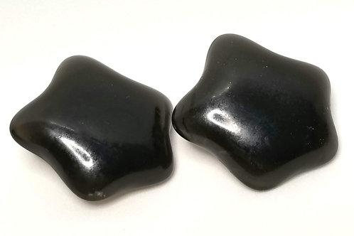 Designer by Liz Claiborne Inc., earrings, clip on black stars in gold tone.