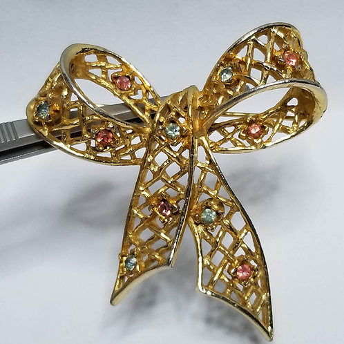 Designer by DeNicola, brooch, bow motif with blue and pink rhinestones gold tone