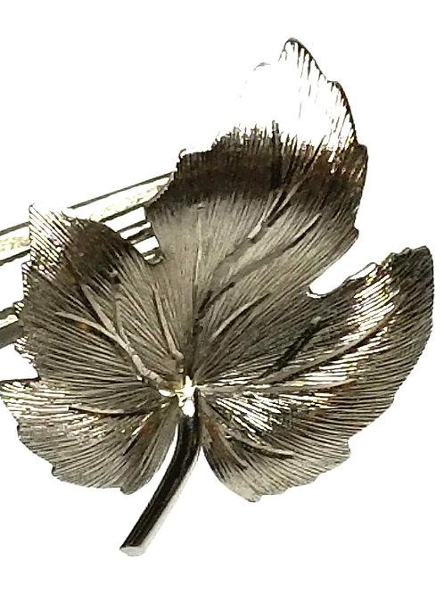 Designer by Krementz, brooch, leaf motif, silver tone, 7/8 x 1 1/8 inches.