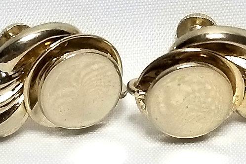 Designer by Coro, earrings, screw back gold tone ribbon motif, 3/4 x 1 inch.