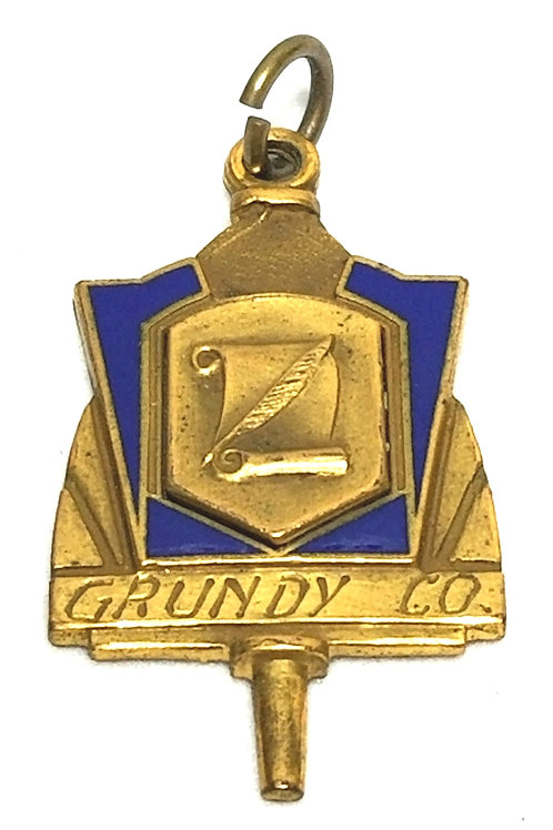 Designer by Grundy Co., pendant, 1938 Humorous award, blue and gold tone.
