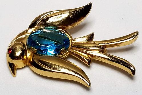 Designer by Coro, brooch, bird motif, blue cabochon in gold tone.
