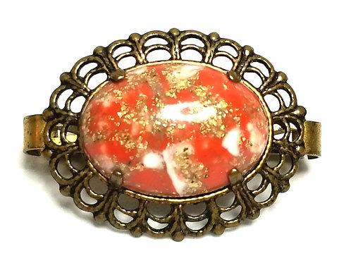 Designer by provenance, brooch, orange/red multi color cabochon, gold tone.