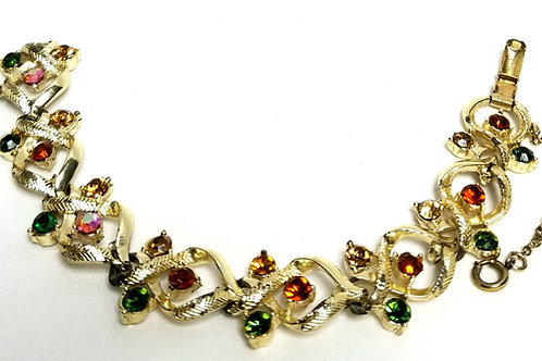 Designer by Coro, bracelet, multi colored rhinestones in gold tone, 7 1/2 inches