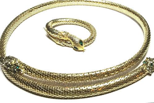 Designer by provenance, set, belt/bracelet, snake motif, green stone eyes.