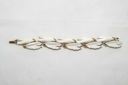 BSK bracelet, white acrylic and gold tone links.