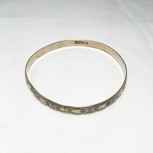 Danecraft bracelet, Sterling bangle with hearts pattern.