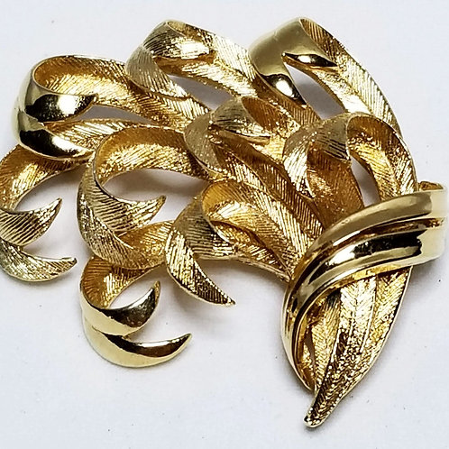 Designer by Lisner, brooch, ribbon motif, gold tone pot metal.