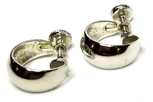 Designer by Monet, earrings, screw back 3/4 hoops, silver tone.
