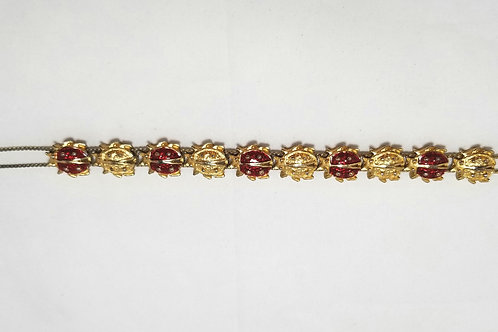 "Designer by provenance bracelet, ladybugs, red and gold colors, 8""."