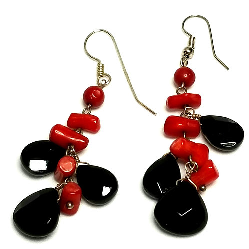 Designer by provenance, earrings, pierced wire dangles, red and black beads.