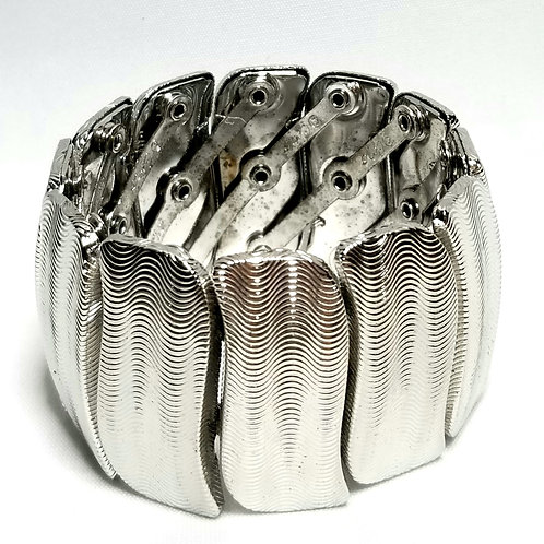 Designer by Coro, bracelet, stretch bangle in textured silver tone.