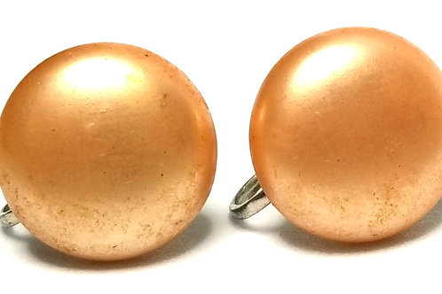 Designer by provenance, earrings, screw back, faux peach pearl cabochons.