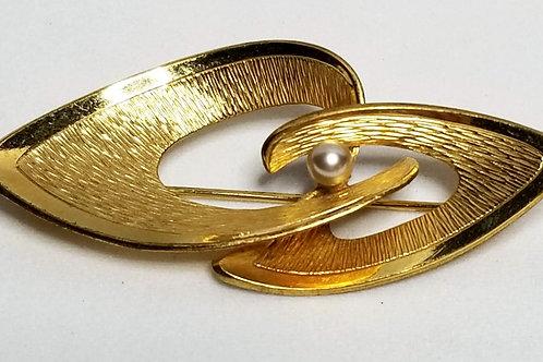 Designer by Kollmar and Jordan, brooch, brushed gold tone pot metal.