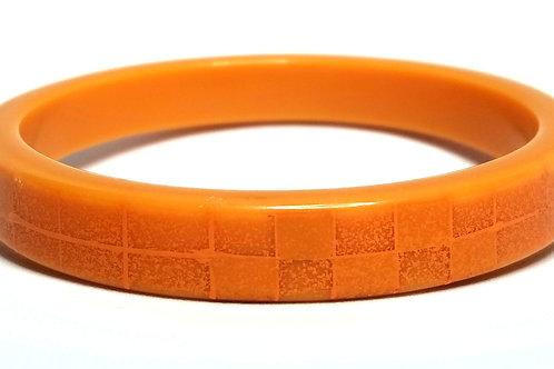 Designer by provenance, bracelet, bangle, orange colored Lucite.