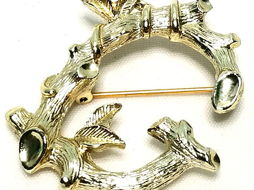 Designer by Sarah Cov, brooch, branch and leaf motif in gold tone.