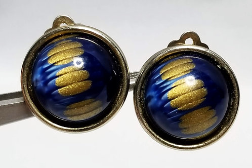 Designer by Lisner, earrings, clip on blue and gold tone cabochons in gold tone.