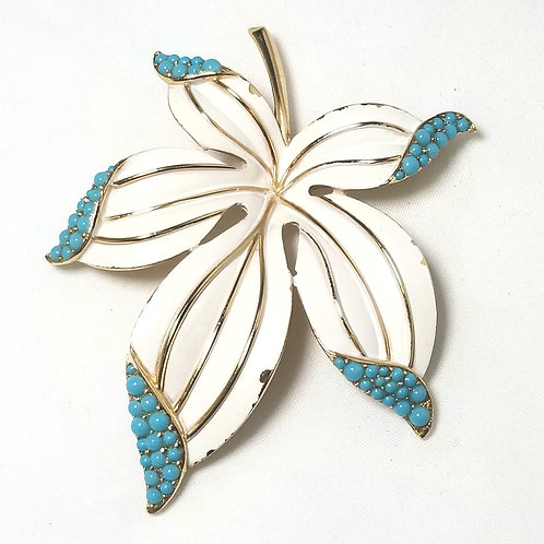 Crown Trifari, white and turquoise enameled gold tone brooch, 2 1/2 x 3 inches