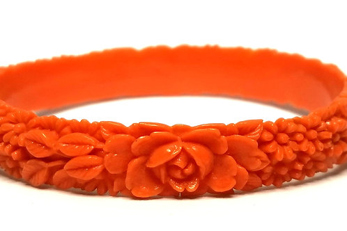 Designer by provenance, bracelet, bangle, floral motif, orange colored Lucite.