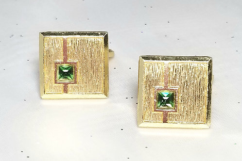Designer by provenance, cuff links, green crystals in brushed gold tone setting