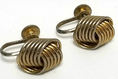 Designer by Coro, earrings, gold tone knot motif, screw back 3/8 x 5/8 inch.
