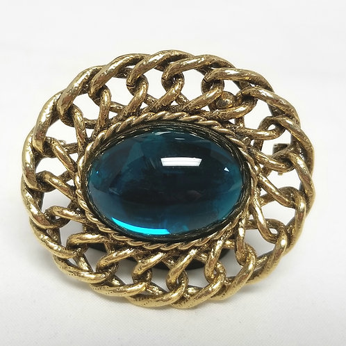 Designer by provenance brooch, blue-green glass oval cabochon, gold tone