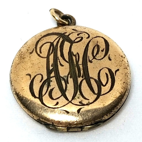 Designer by SKM Co., pendant/locket, gold tone with initials ATC.