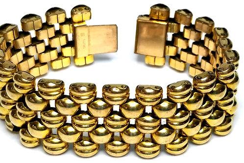 Designer by provenance, Made in Switzerland, bracelet, links, gold plated.
