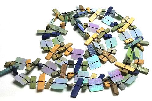 Designer by provenance, necklace, multi color plastic paillettes, black wire.