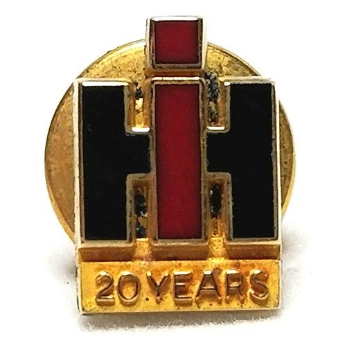 Designer by provenance, pin, International Harvester 20 year motif, multi color.