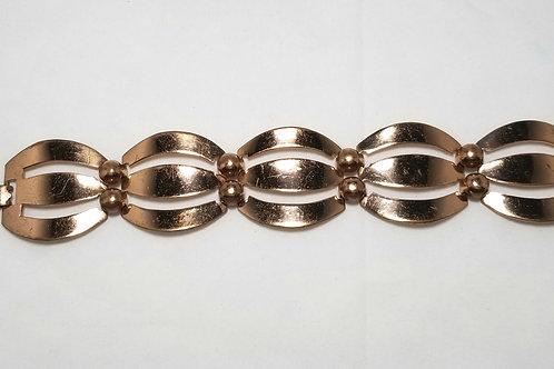 """Designer by provenance, bracelet, copper color metal, 7.5""""."""